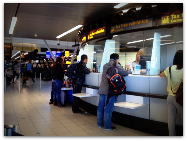 Customs counter inside Schiphol Airport